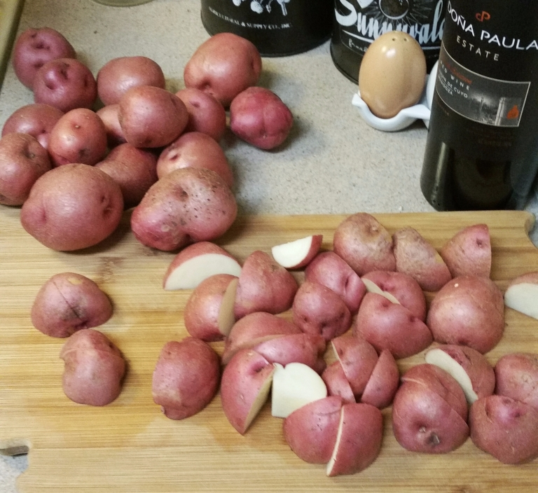 picture of red potatoes on cutting board
